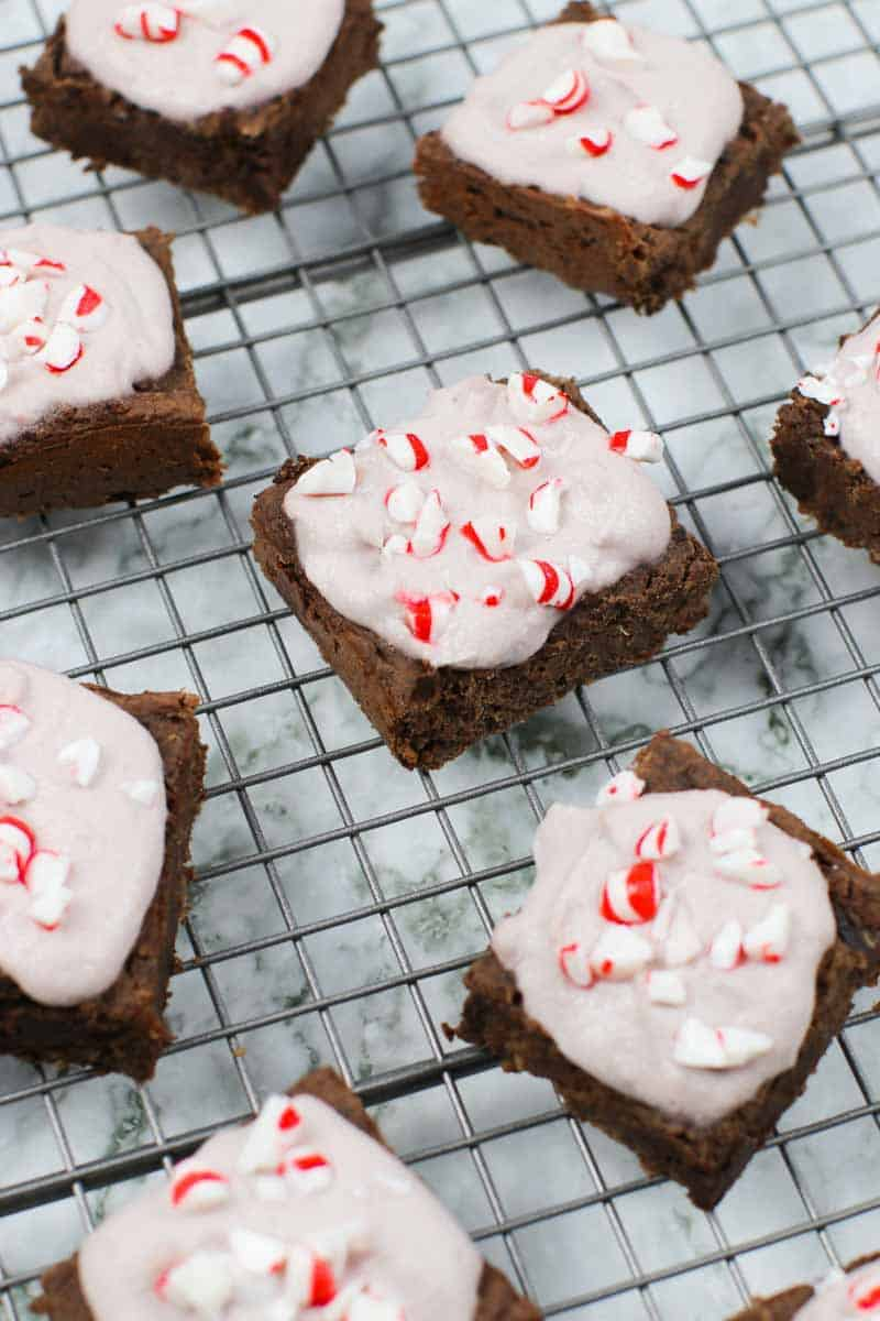 Healthy Brownies With Peppermint Frosting on a cooling rack with peppermint candies