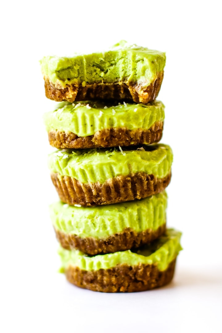 vegan key lime pie mini tarts in a stack with a bite out of top tart.