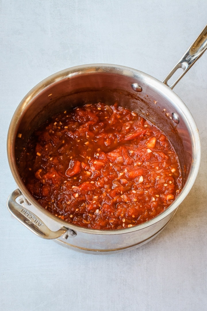 Satuteed Tomatoes and other ingredients (except chia seeds) in a sauce pan.