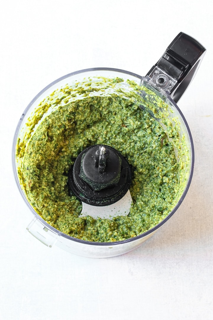 Food processor bowl with oil-free pesto.
