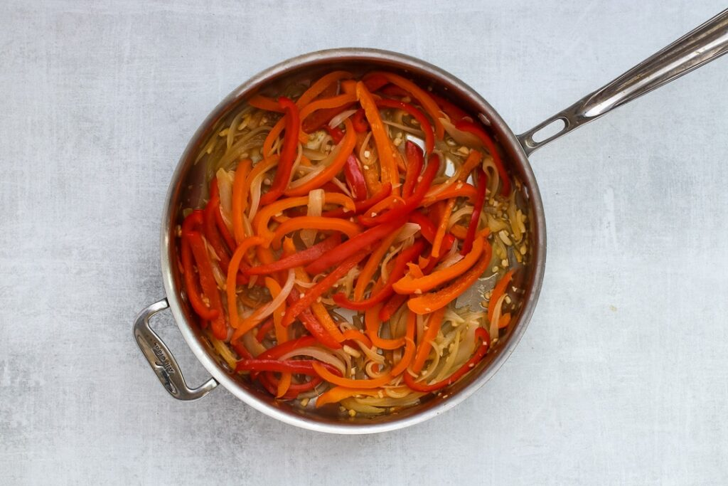 Step 1: Saute the slivered onions, peppers and garlic in a skillet.