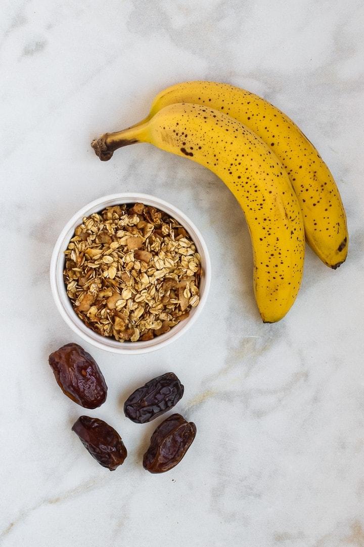 vegan oatmeal cookies ingredients: 2 ripe bananas, 4 Medjool dates, bowl of sugar free granola