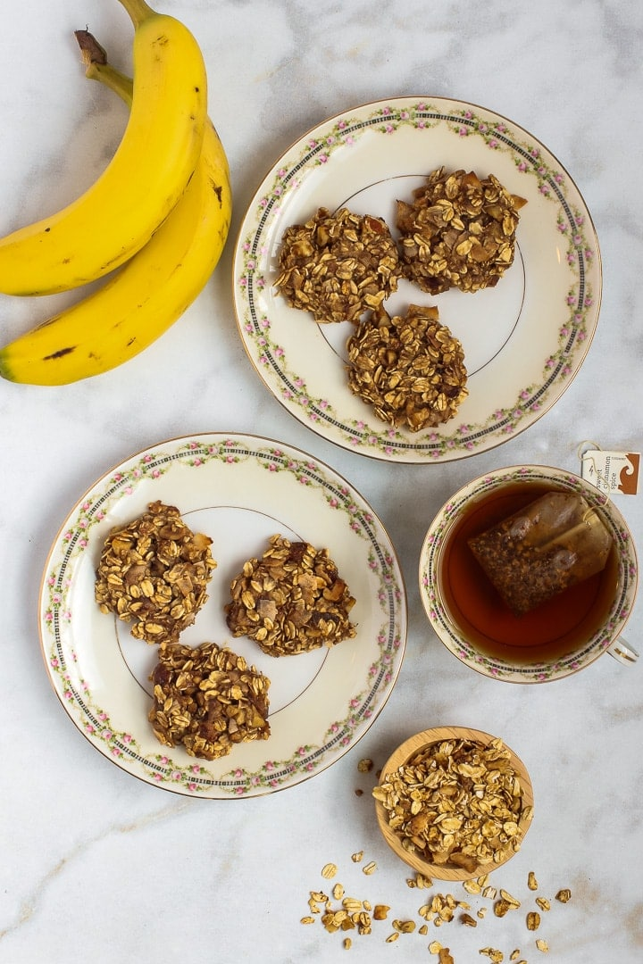 cookies on antique plates with bananas and tea