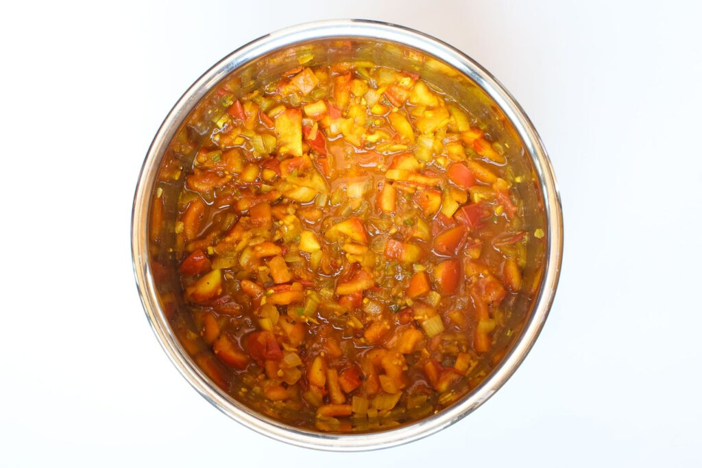Sautéed veggies and spices with tomato.