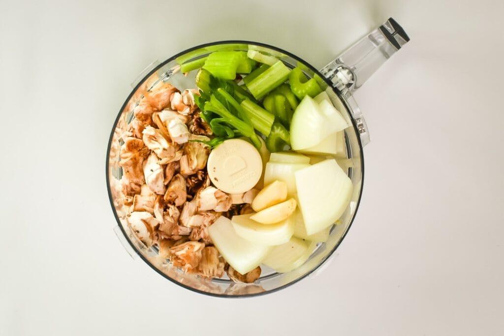 Mushroom stems, onion, garlic and celery in a food processor.