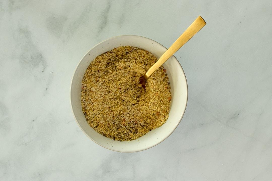 For the topping, combine bread crumbs, vegan Parmesan and Italian seasonings.