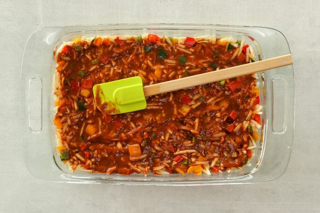 Pour the enchilada sauce evenly over the casserole.