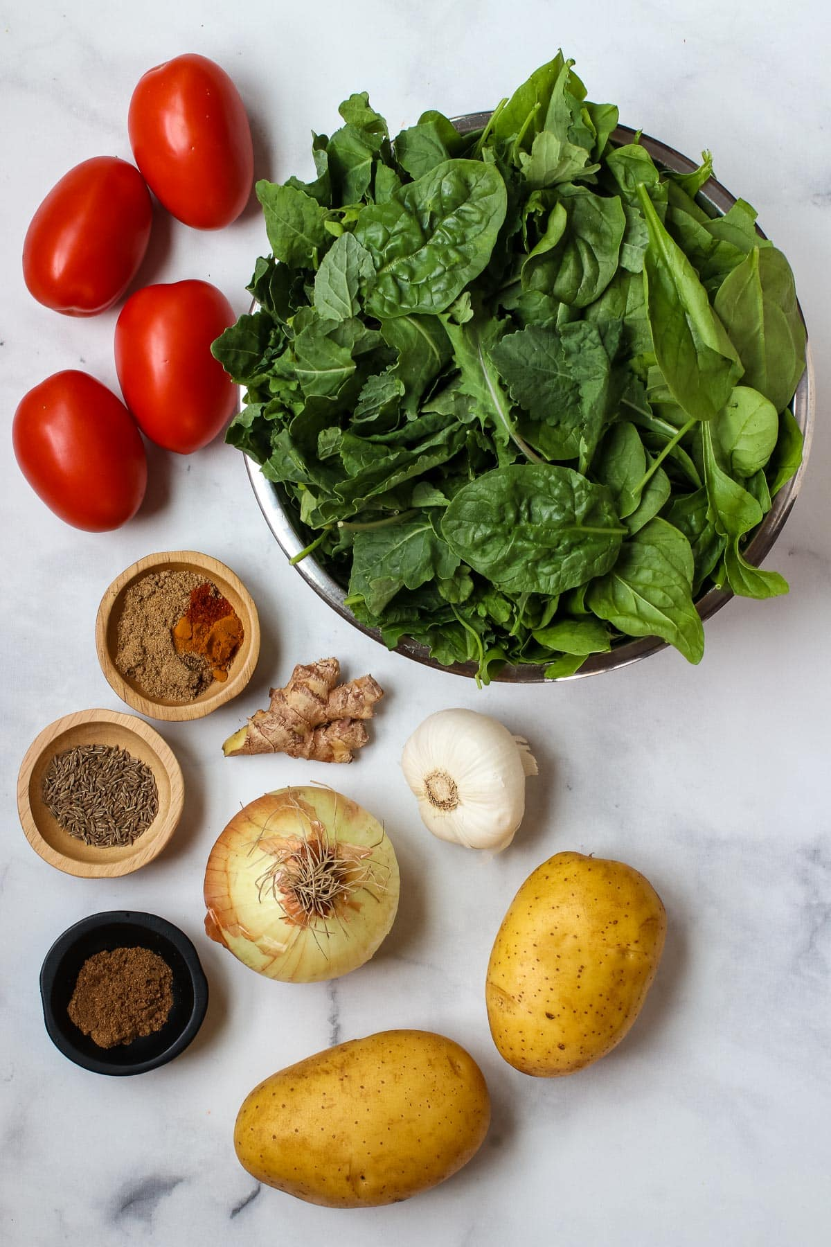 Spinach Potato Curry ingredients: spinach, tomatoes, potatoes, onion, garlic, ginger and spices.