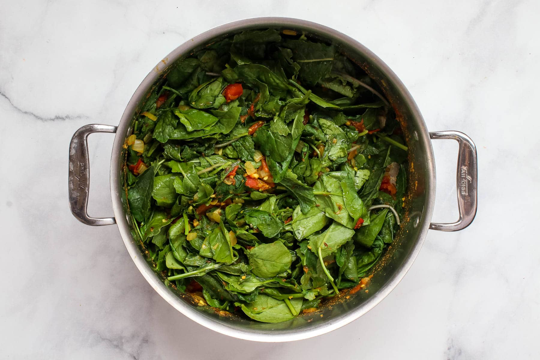 Pot of wilting spinach.