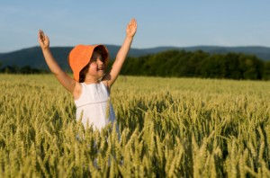 Child Frolicking in Wheat Field