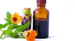 Fresh Herbs beside Herbal Medicine Bottle