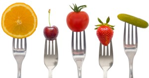 Different Forks Holding Different Fruit