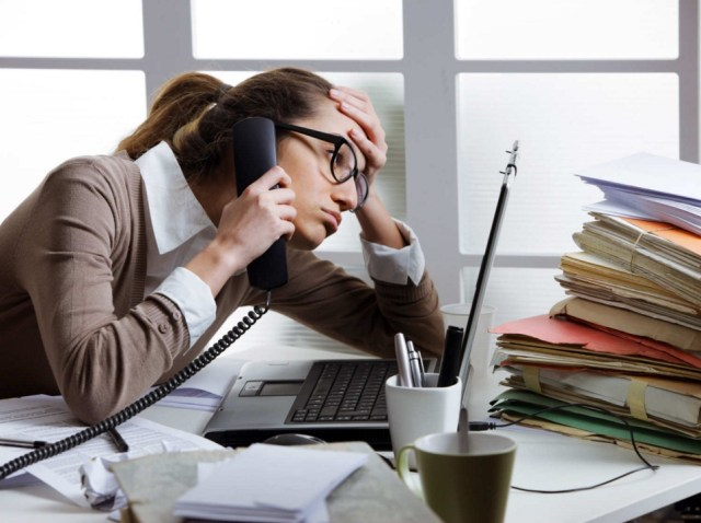 woman stressed at office