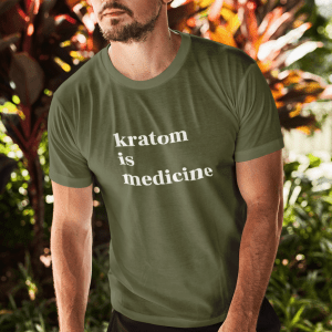 white man with sunglasses on wearing olive kratom is medicine shirt