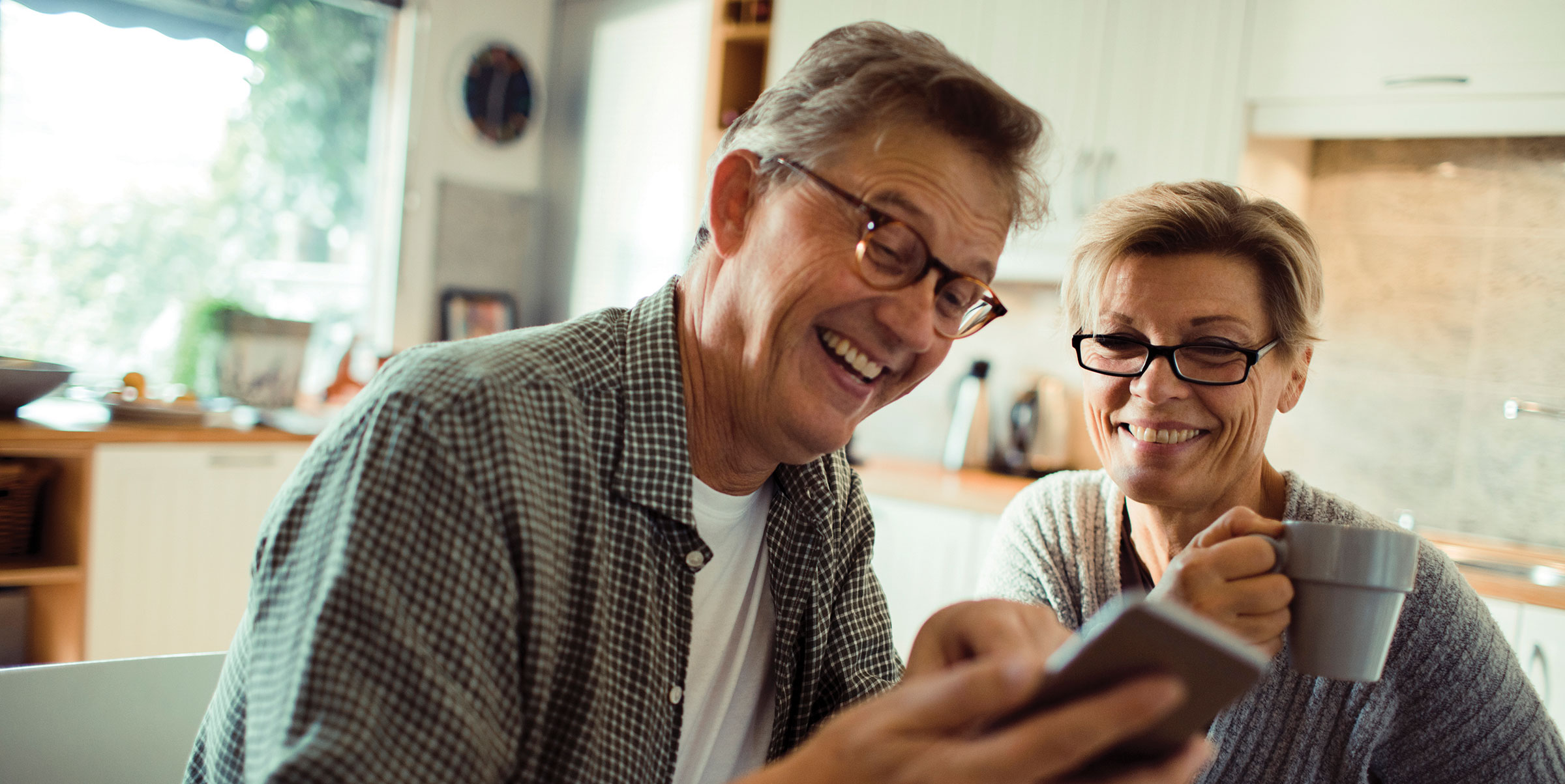 Couple using hearing aid technology for their smartphones