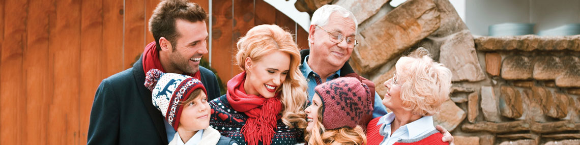 a multigenerational family cherishes their moments together despite hearing difficulties