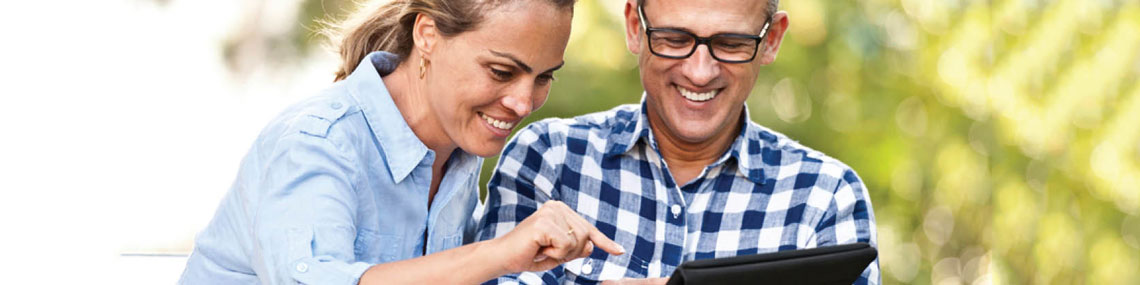 a couple shares their opinion by reviewing a company via tablet device