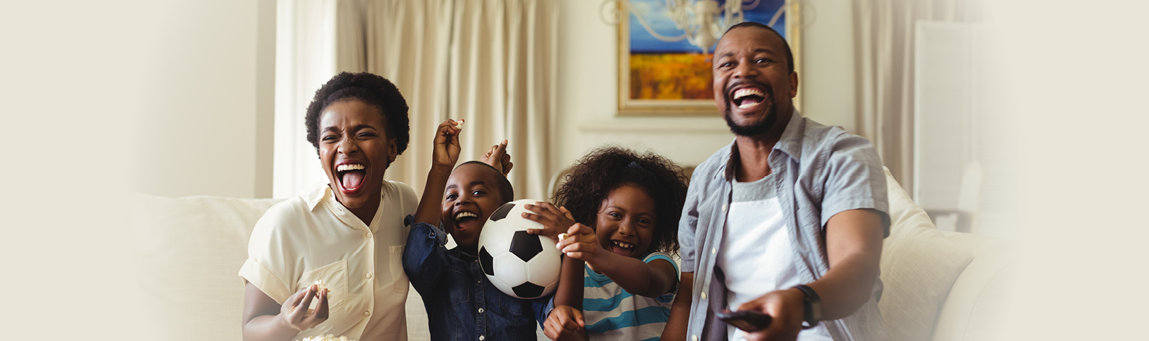 a family enjoying tv together despite differing levels of hearing ability