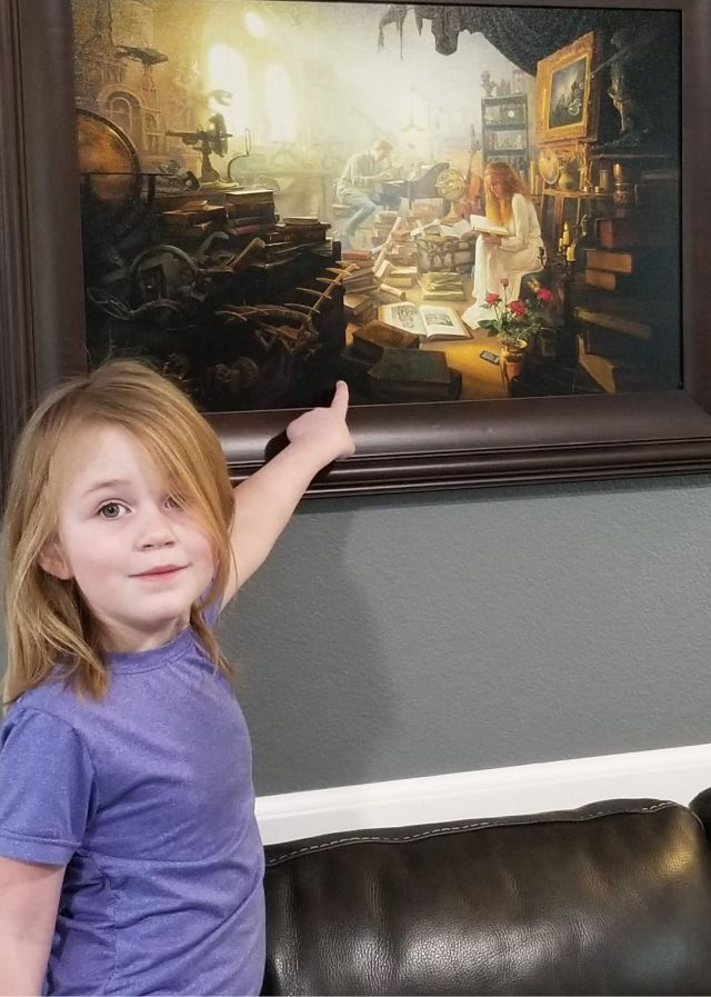 Girl pointing to painting, heart-based education