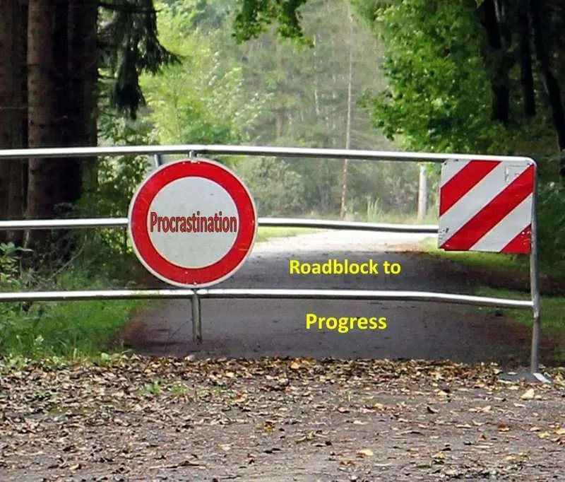 Road blocked by barrier with the title Procrastination - Roadblock to Progress.