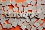 Scrabble tiles spelling out the word vision.