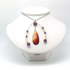 Red agate teardrop pendant with beaded horseshoe embellishment detail