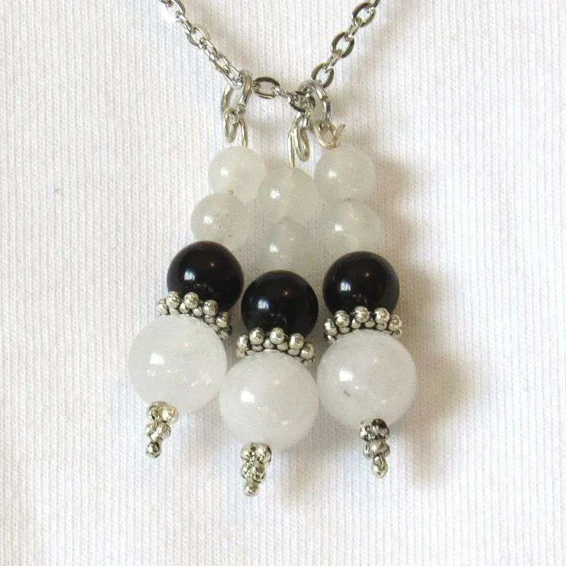 Obsidian & snow quartz bead drops closeup