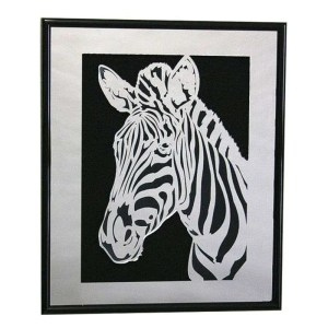 Mirrored plastic zebra wall hanging.