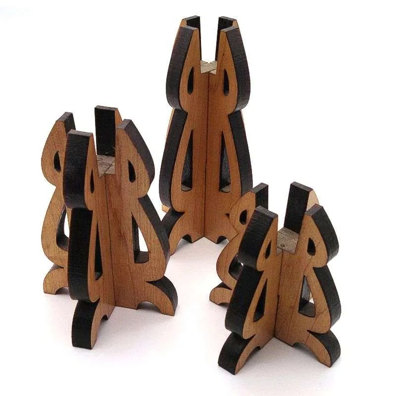 Cherry wood laser carved taper candle holder trio.