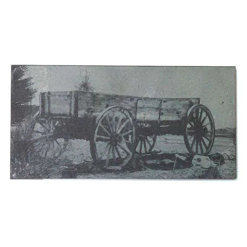 Old wagon laser engraved on slate.