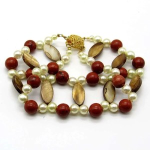 Fancy bracelet with creamy brown beads accentuated with red jasper and pearls.