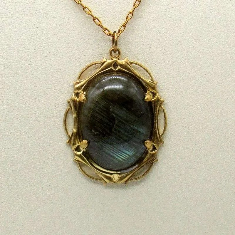 Labradorite cabochon in antique gold setting.