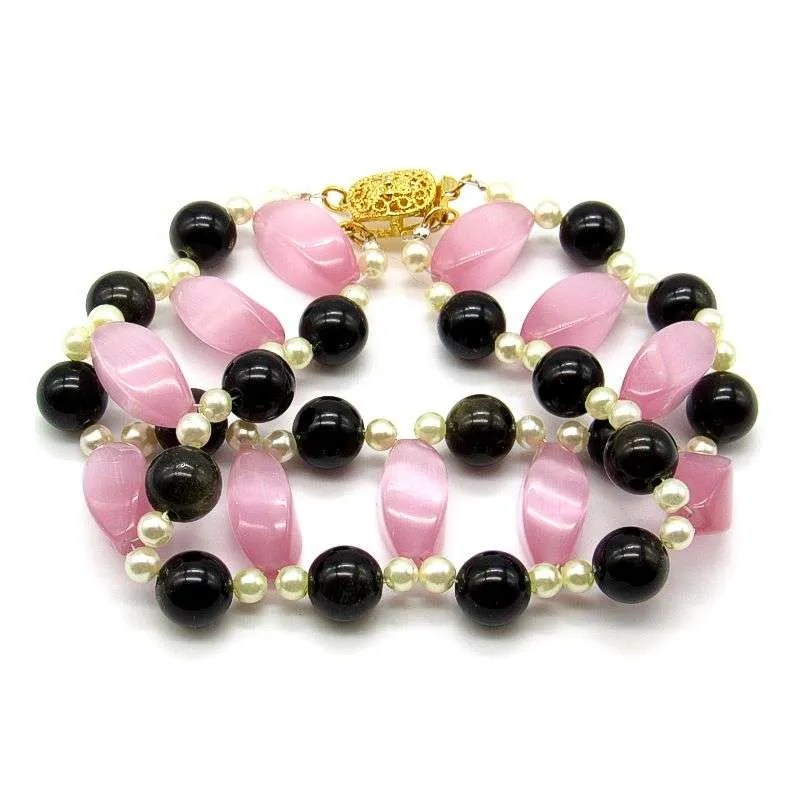 Fancy bead bracelet with pink glass and goldsheen obsidian beads.