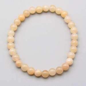 Peach quartz 6mm gemstone bead bracelet.