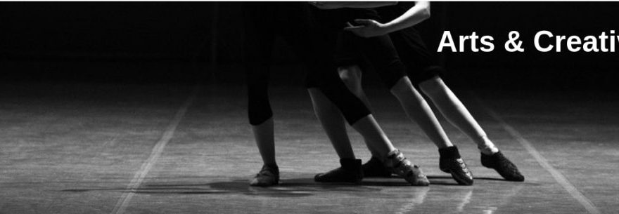 A black and white photo of people dancing showing their legs only