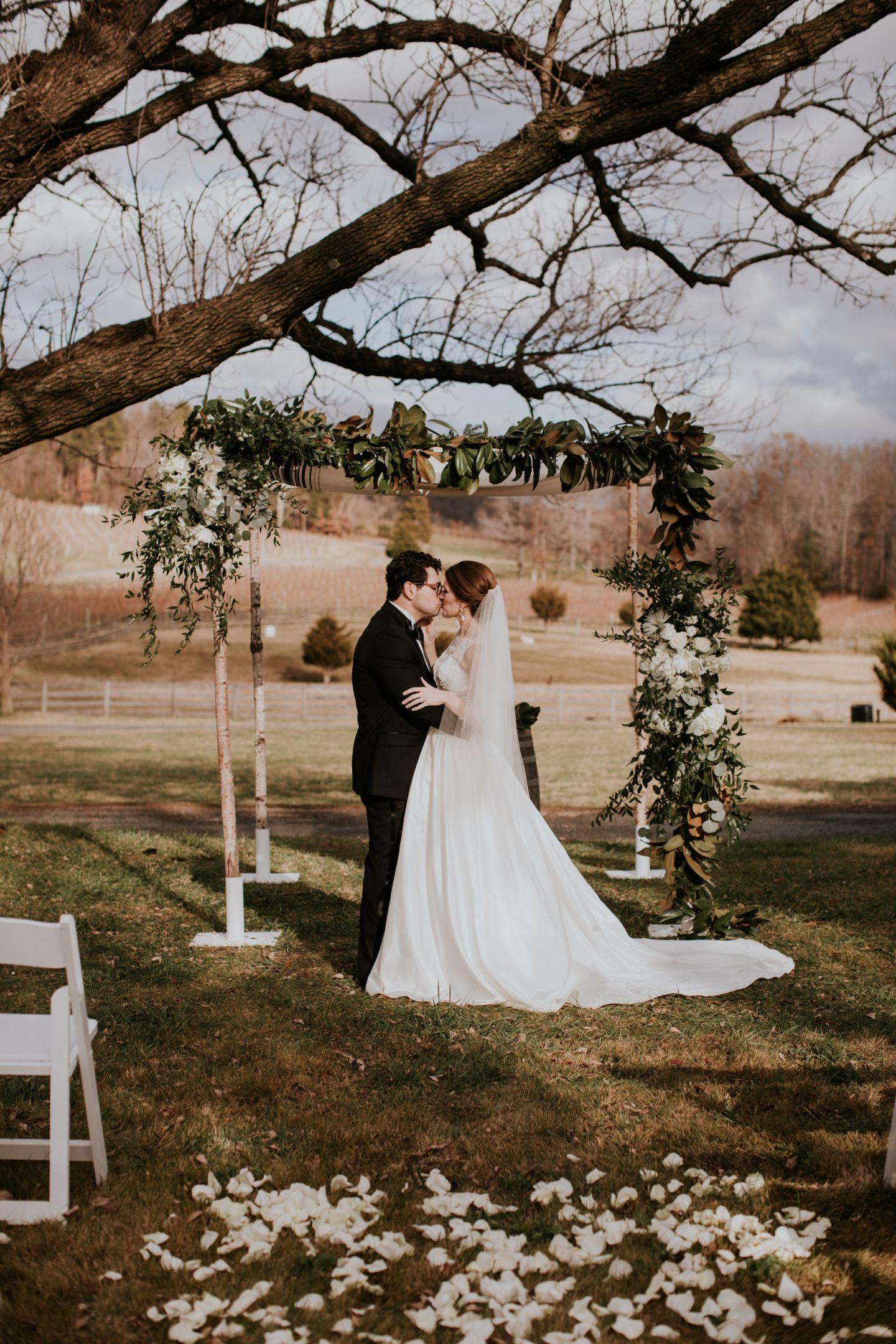 winter wedding flowers - winter chuppah - chuppah with magnolia