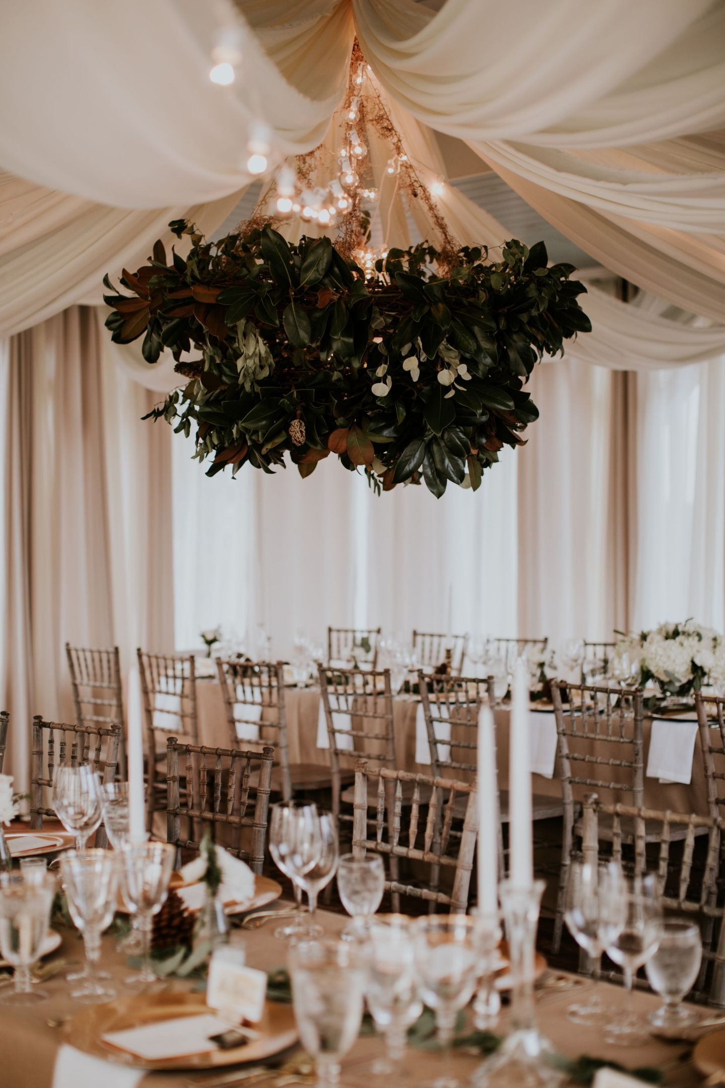 winter wedding flowers - magnolia chandelier - magnolia leaves winter wedding