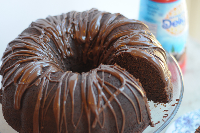 Peppermint Mocha Chocolate Bundt Cake is a new holiday favorite you'll love to share. Rich, chocolate cake drizzled with an easy peppermint mocha fudge sauce, this dessert will have you coming back for more. #IDelight #sponsored