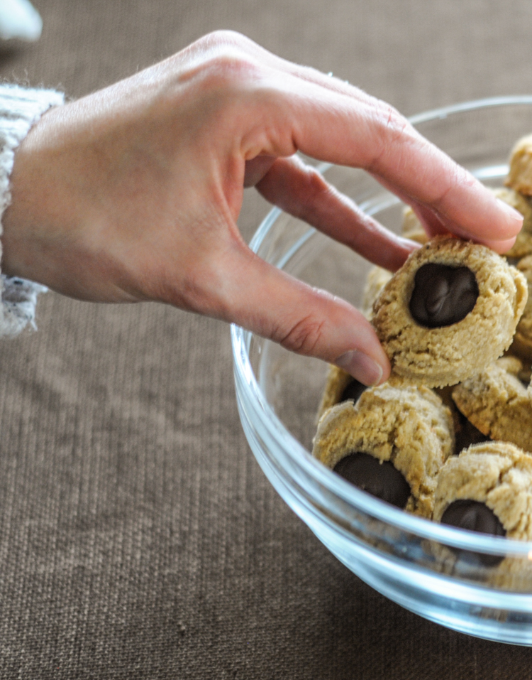 5 Ingredient Gluten Free Almond Thumbprint Cookies. These adorable little cookies can be filled with any concoction of deliciousness, although chocolate is always my sweet of choice. Perfect for any holiday cookie plate, these allergy-friendly cuties are sure to please!