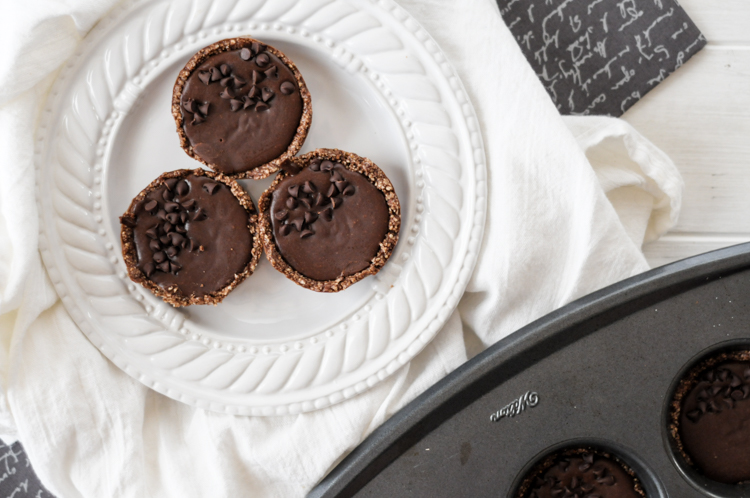 Dark Chocolate Peanut Butter Tarts are a fantastic paleo-friendly, gluten-free dessert you can feel good about eating. So rich, so chocolatey!