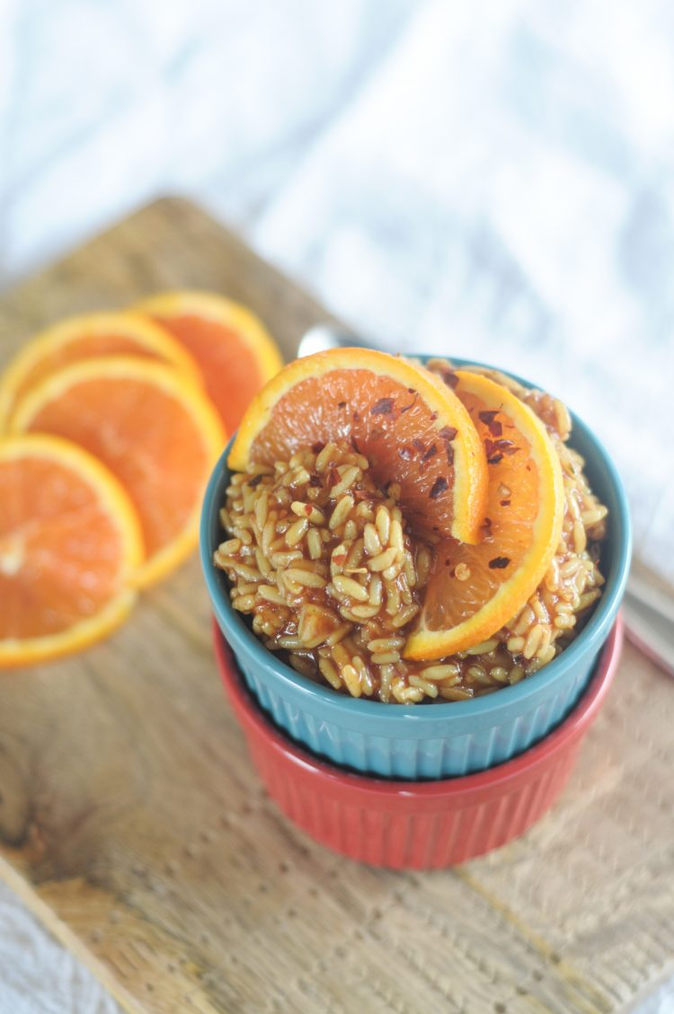 Saucy Asian Orange Rice is a simple side dish that will elevate your meal to the next level! Thick, rich, unctious and naturally sweet sauce wraps around every grain of perfectly cooked @RicelandFoods rice for an unforgettable side dish! @heathersdish #RicelandFoodsPartner