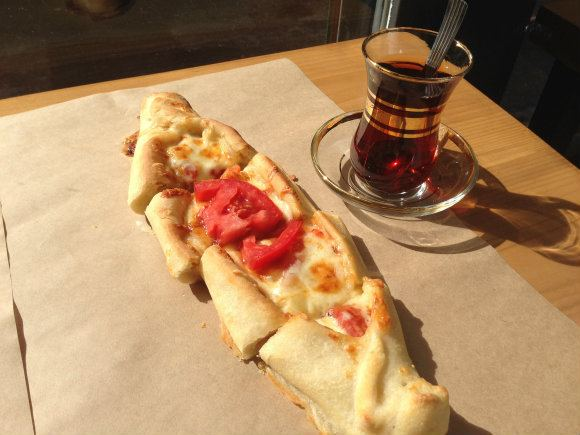 Peinirli or open topped pie served at Feyrouz in Athens with Turkish tea Photo: Heatheronhertravels.com