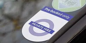 pre booked sticker on a privately reserved taxi