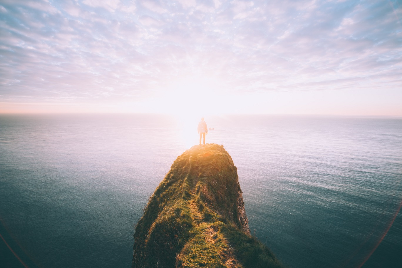 man standing on a rock by himself