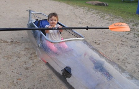 Zinnia May Hebel in a clear kayak