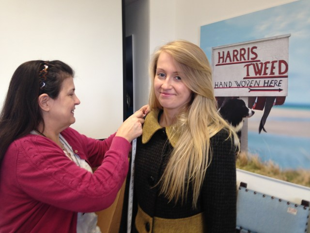 Picture of Paulette of Rarebird fitting a coat for the fashion show