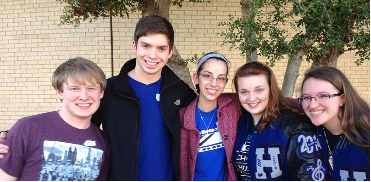 Choir members Michkael Rumpuff, Patrick Warren, Kathryn Brode, Gillian White and Kaylee Hairel pose outside of the school. All five members will be performing at a concert in San Antonio for making the All-State choir.