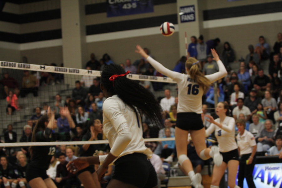 Junior+middle+hitter+Emma+Clothier+prepares+to+hit+the+ball.+She+received+the+point+with+a+kill.+