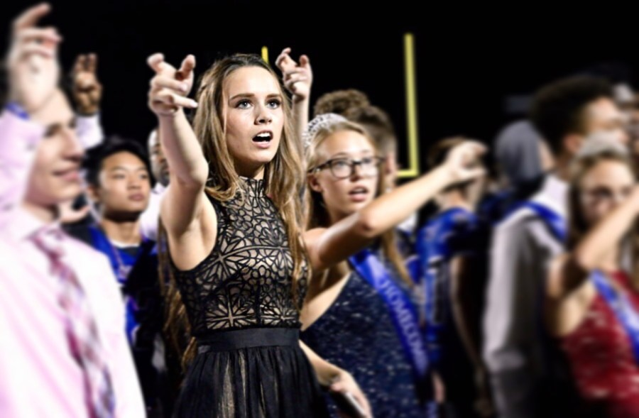Senior+Skylar+Boyd+sings+the+alma+mater+with+the+rest+of+the+students+during+the+Homecoming+game.+Boyd+was+one+of+the+Homecoming+Queen+nominees.