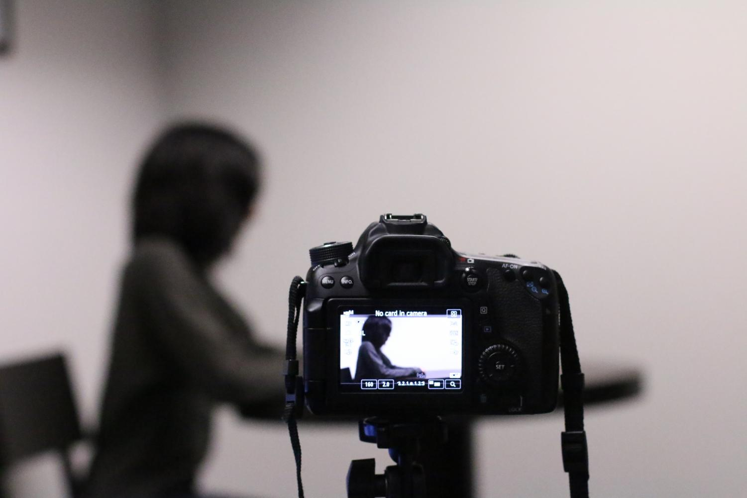 Photo illustration of student filming.